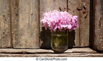 Flowers in a jug outdoors