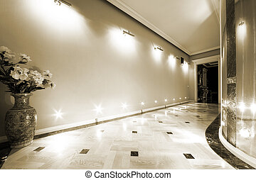 flowers in a long hallway with parquet flooring