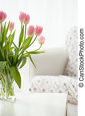 Beautiful fresh flowers in a vase on a table
