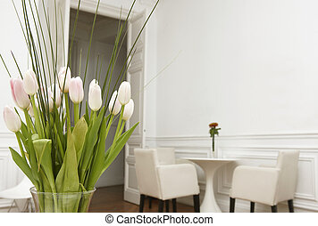 Flowers in a white room home interior