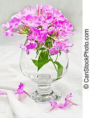 Flowers in a wine glass.
