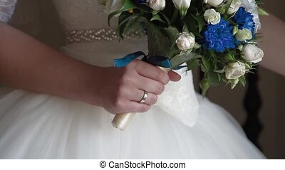 flowers in the bride's hands