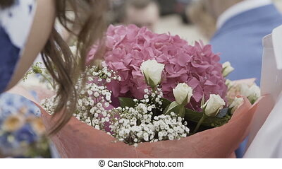 Flowers in the hands of a woman