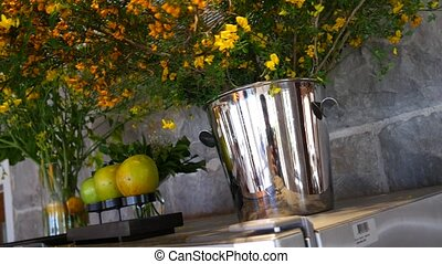 Flowers in the vases on the refrigerator in the restaurant and a