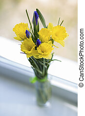 Flowers in vase on white window sill