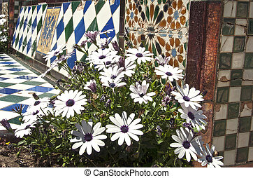 flowers on a background of traditional Spanish mosaic