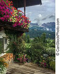 Flowers on a balcony in mountain scenery
