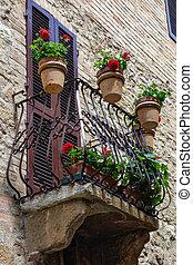 Flowers on a balcony in Pienza Tuscany