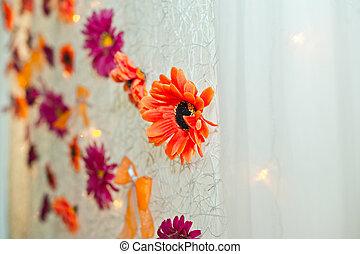 Flowers on a curtain.
