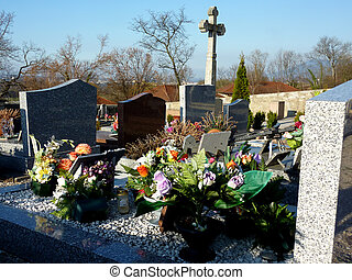 Flowers on a tomb - Lots of beautiful flowers covering a...