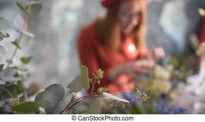 Flowers on blurred background florist girl making a flower composition