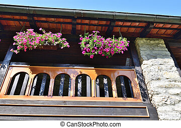 Flowers on the balcony of the old house in Montenegro