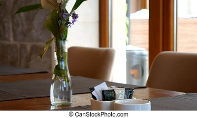 Flowers on the table in the restaurant. Table setting