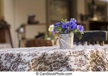 Flowers on the table of street cafe, Lviv, Ukraine