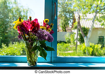Flowers on the window - Bouquet of beautiful flowers on the ...