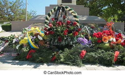 Flowers on war memorial - Remembrance wreaths and flowers on...