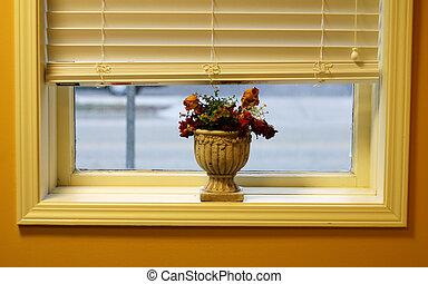 Flowers on window will