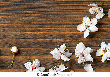 flowers on wooden background, grain wood texture