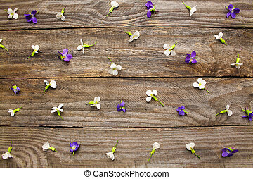 Flowers on wooden background. Top view.