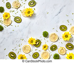 Flowers pattern from natural yellow green flowers, slices fruits, green flower petals. Space for text.
