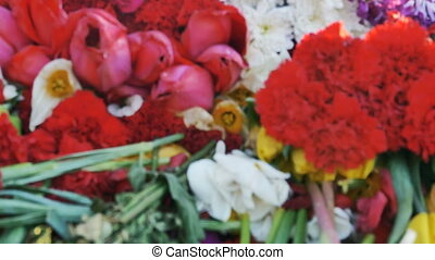 Flowers placed at a monument for victory day of World war 2,...