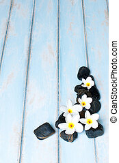Flowers, stones on wooden floor.