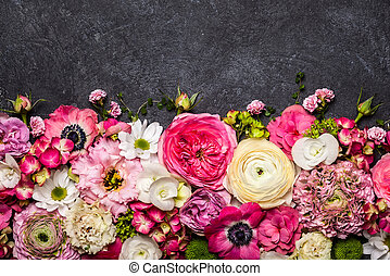 Flowers - Various flowers on black background. Overhead view...