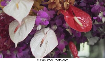 Flowers with fake butterfly - Closeup of flowers with fake...