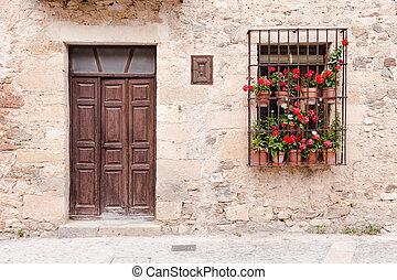 Flowery entrance - An old flowery facade in Spain