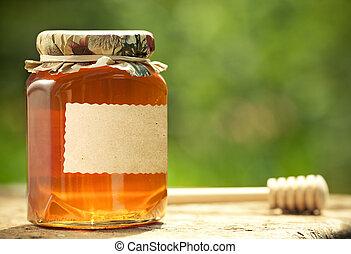 Flowery honey in glass jar - Honey jar with blank paper...