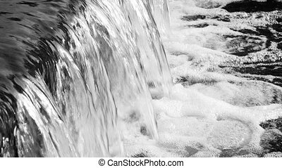 Flowing river water close-up. - Peaceful flowing water in...