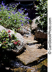 Flowing stream of a water feature - landscaped water feature...