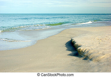 flowing tide at the gulf of mexico - the incoming tide on...