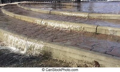 Flowing water on asphalt road after rain storm - Close up...