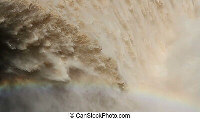 Flowing water - Strong flowing water with water spray and...