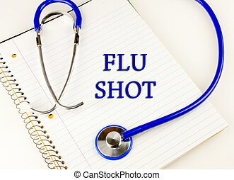 Flu Shot - Flu shot text over a white notebook wrapped in a...