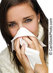 flu - young brunette woman having a cold close up
