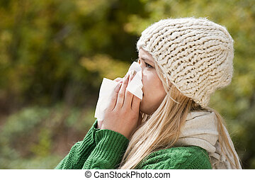 Flu - Young woman blows his nose