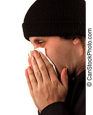 flu symptoms - man blows nose