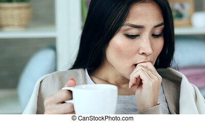 Flu Tab - Close up of woman having cold taking a pill