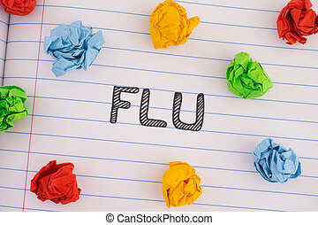 The word Flu on notebook sheet with some colorful crumpled paper balls around it
