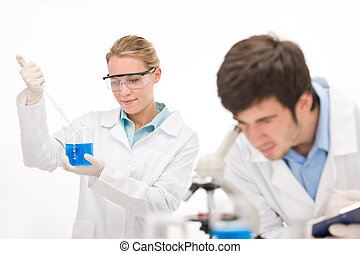 Flu virus experiment - scientist in laboratory with...