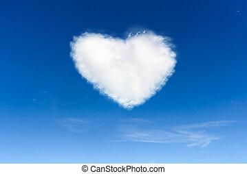 Fluffy cloud of the shape of heart, on a deep blue sky.
