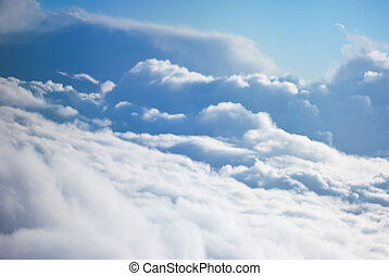 Fluffy clouds from above - Fluffy clouds on blue sky seen ...