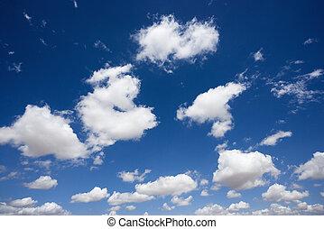 Fluffy clouds in sky. - Fluffy cumulus clouds in blue sky.