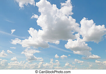 fluffy clouds in the blue sky