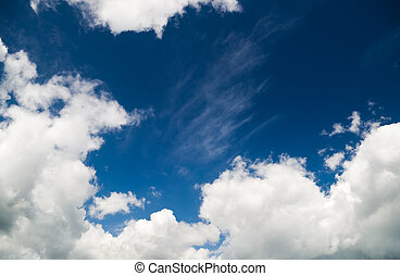 fluffy clouds in the blue sky. Nature composition.