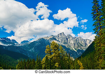 Canadian Rockies - Fluffy clouds over Canadian Rockies