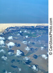Fluffy clouds over wadden sea in Germany