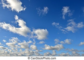 Fluffy clouds in the otherwise clear sky